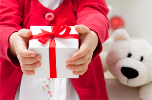 A child holding a gift box